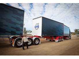 The two drivers hook up the well-known Australian B-triple rig.
