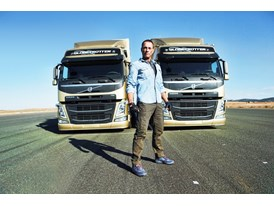 Jean-Claude Van Damme posses in front of the two Volvo FMs that co-star alongside him in 'The Epic Split'.