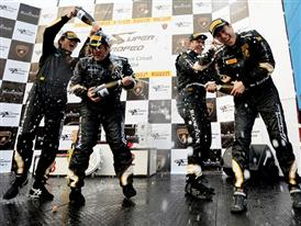 Champaign at the Winners Podium