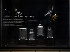 Automobili Lamborghini luggage by Tecknomonster at La Rinascente Milano by night