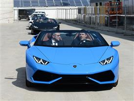 S. Domenicali e M. Renzi driving the Huracán Spyder