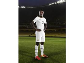 Asamoah Gyan in the 2014 Ghana Home Kit that features PUMA's PWR ACTV Technology