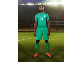 Yaya Touré in the 2014 Ivory Coast Away Kit that features PUMA's PWR ACTV Technology