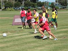 adidas & SCORE staff play with professional football players from Ajax Cape Town