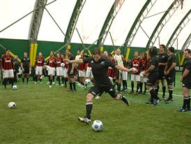 McCaw kicking football