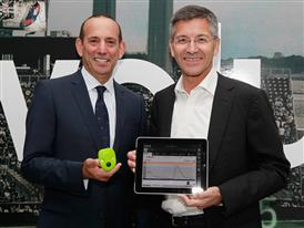 Herbert Hainer and Don Garber with the adidas micoach elite system