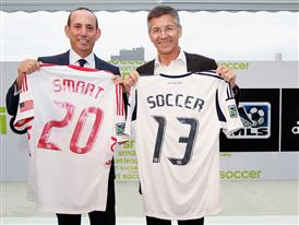 Herbert Hainer and Don Garber with the adidas micoach elite system with MLS shirts