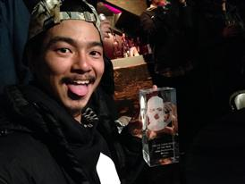 Kazu celebrating with the award