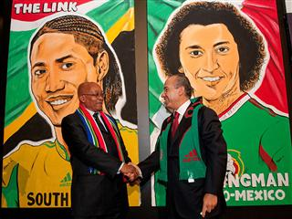 South African President Jacob Zuma and the President of Mexico Felipe Calderón sign the Player Portraits prior to the opening match of the 2010 FIFA World Cup ™.