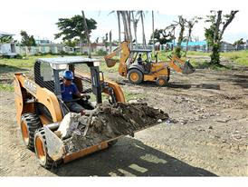 The Case 580SN backhoe loader and SR150 skid steer loader clear out debris on the Bethany Hospital site