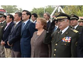 Minister of the Interior, Rodrigo Pe+¦ailillo left of President Michelle Bachelet and Miguel Reyes