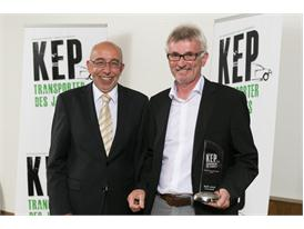 Werner Bicker Publisher and Editorial Director of ETM (left) presents KEP award to Manfred Kuchlmayr, Head of the Iveco