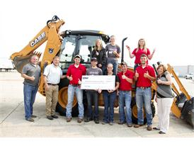 Students and staff of Southeastern Community College surround the new CASE backhoe