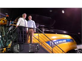 The Governor of Nebraska, Pete Ricketts stands on a New Holland combine