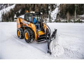 Case SR240 Skid Steer Loader equiped with a front mounted blade for clearing snow
