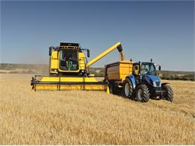 New Holland TC5070 Combine Harvester unloading