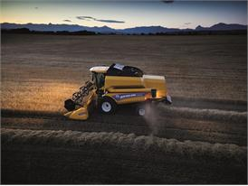 New Holland TC5070 Combine Harvester working at night with powerful field lights