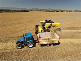 New Holland TC5070 Combine Harvester unloading