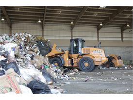 Case 721F Wheel loader conducting waste management activities