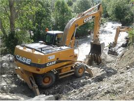 Case WX210 wheeled excavator repairing river banks in Europe following flooding