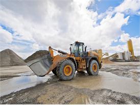 Case 1121F wheel loader hard at work moving aggregate