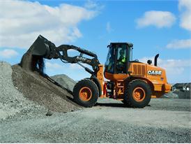 Case 621FXT wheel loader moving aggregate