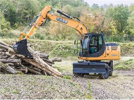 Case WX148 wheel loader moving logs