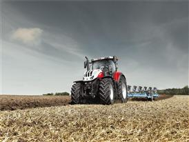 Steyr 6300 Terrus CVT with 7 furrow plough