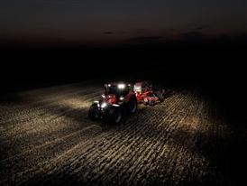 Case IH Optum 300 CVX working at night with a seeder