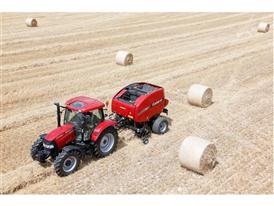 RB465 Variable Chamber Round Baler in straw