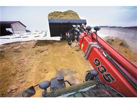 Farmlift loading silage in a bucket