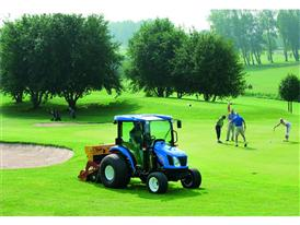 New Holland Boomer™ 54D EasyDrive on a gold course