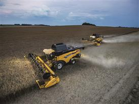 New Holland CX8.80 Elevation Combine Harvester in the Field working at dusk due to the outstanding light performance