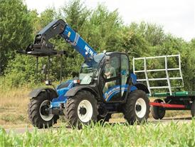 New Holland LM7.35 Telehander towing a bale trailer