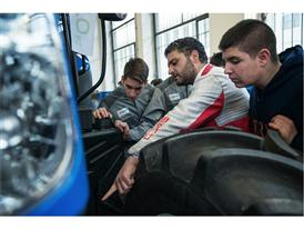 TechPro2 students learning about tractor maintenance on a donated New Holland Agriculture T6 tractor