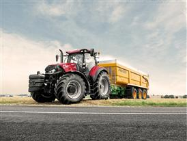 Case IH Optum 270 CVX with Trailer in the Field