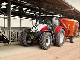 Steyr 6145 Profi Tractor with a feeder wagon