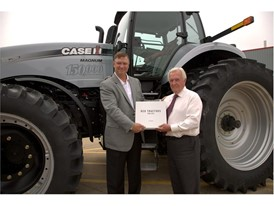 Jim Walker, Vice President, Case IH NAFTA, presents Gerry Forsythe with the 150,000th Magnum tractor
