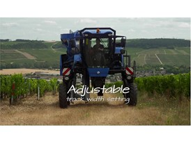 Adjustable track width setting on a New Holland Agriculture grape harvester