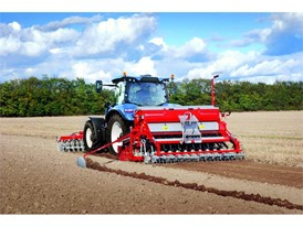 A New Holland Tractor working with a Seed Drill