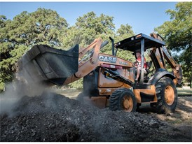 CASE 580N moving aggregate during construction of the San Marcos skate park in Texas