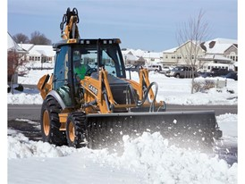 Auxiliary hydraulics help backhoes power attachments, such as snow blowers and brushes