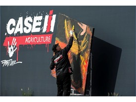 "Dan Dunn, Paintjam speed painter, creates a painting commemorating ""Year of the Farmer"" during the Case IH arena show"