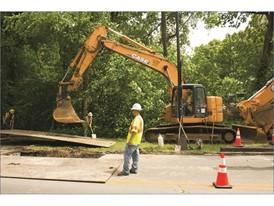 Southern Pipeline crews work on a roadside utility project in Louisville, Kentucky