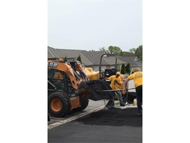 Crews work on a driveway project with a Skid Steer Loader
