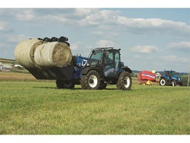 LM9.35 Telehandler moving two round bales