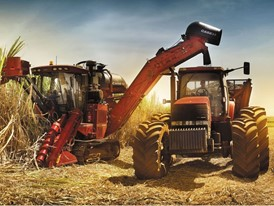 Case IH sugarcane harvester and tractor at work in the field