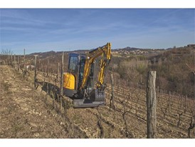The latest New Holland Construction mini-excavator working amongst the vines