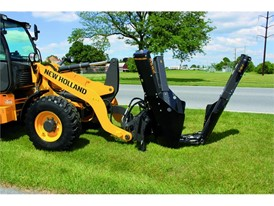 New Holland Construction Wheel Loader with a tree removal implement attached