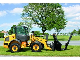 New Holland Construction with a tree removal implement